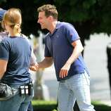 """Bradley Cooper shakes hands with police officers before entering Schenectady City Hall for the day's filming of """"The Place Beyond the Pines"""" on Friday, Aug. 12, 2011, in Schenectady, N.Y. Cooper?s character is a rookie cop who eventually ascends to political power. (Cindy Schultz / Times Union archive)"""