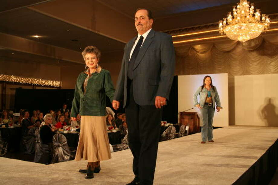 Fort Bend County Fair president A.J. Dorr and his wife, Sandra, model at the fair luncheon and style show in 2007. Photo: Suzanne Rehak, For The Chronicle