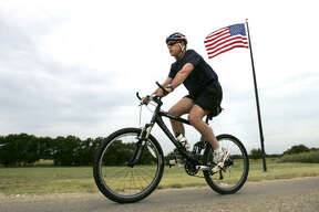 The town's most famous neighbor is nearby Crawford ranch of President Bush, who here takes his bike for a ride on the property.
