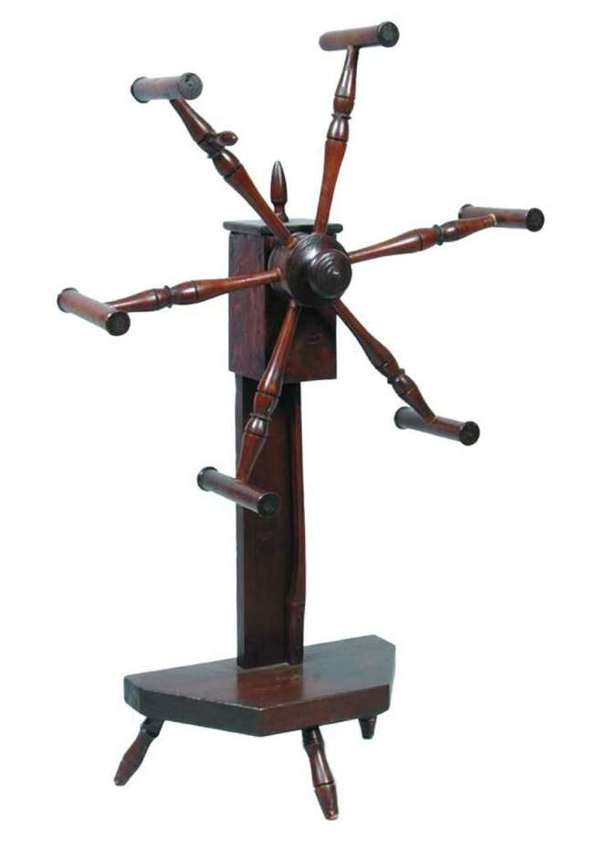 This wool winder, made in Pennsylvania in the 19th century, was refinished, so it sold for only $34 at Conestoga Auction Co. in Manheim, Pa. Photo: Contributed Photo