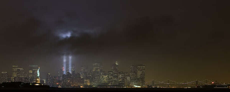 "The ""Tribute in Light"" marks the 9/11 anniversary in New York, as seen from Bayonne, N.J. Photo: Tim Larsen, AP"
