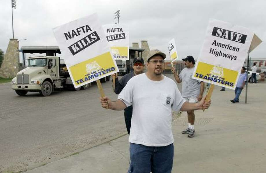 Teamsters gather at Laredo to protest a new pilot program that will allow 100 Mexican truck carriers to transport cargo throughout the U.S. Photo: Eric Gay, AP