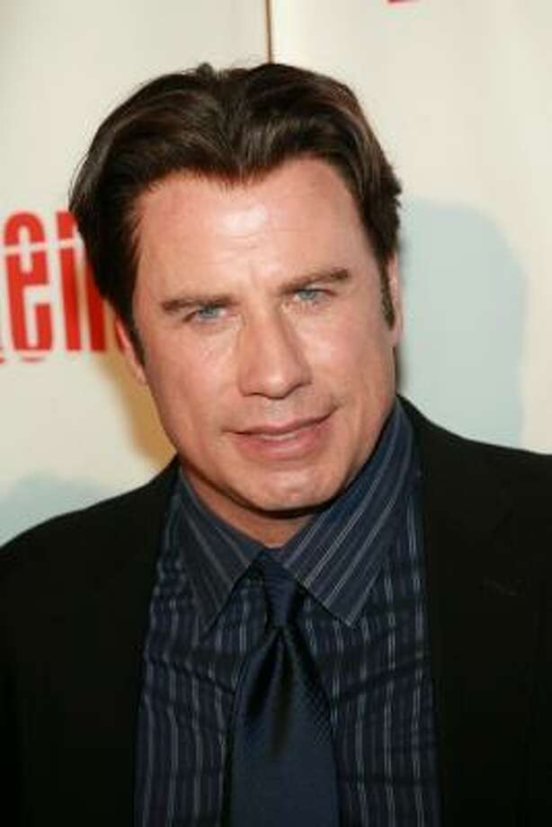 Unconfirmed: Either John Travolta has a really good head of hair still or. ... Photo: Evan Agostini, Getty Images