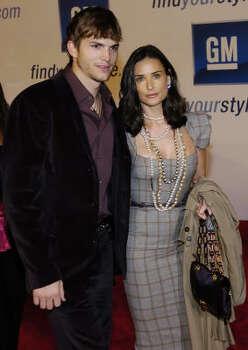 Ashton Kutcher and wife, Demi Moore Photo: CHRIS PIZZELLO, AP