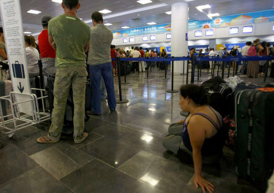 Fleeing tourists pack the Cancun airport Sunday. Dean is expected to slam into the Yucatan peninsula late Monday. Photo: OMAR TORRES, AFP/Getty Images