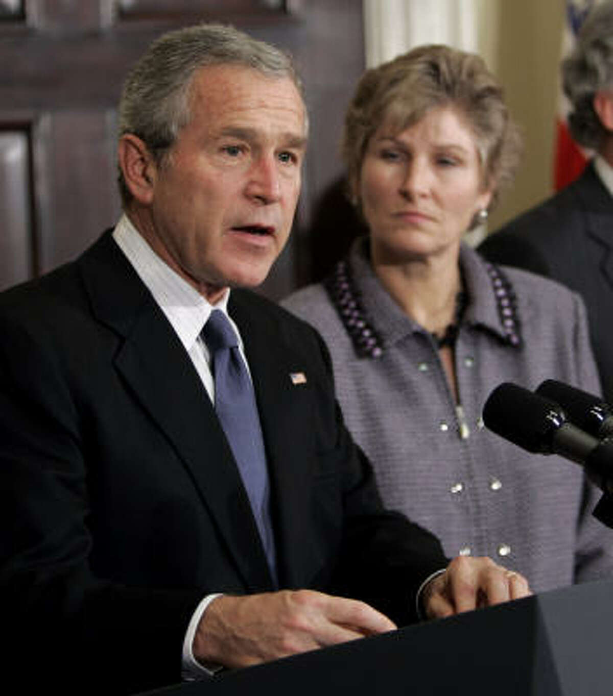 Undersecretary of State for Public Diplomacy Karen Hughes, right, looks on as President Bush makes a statement on south Asia earthquake relief efforts on Nov. 9, 2005.