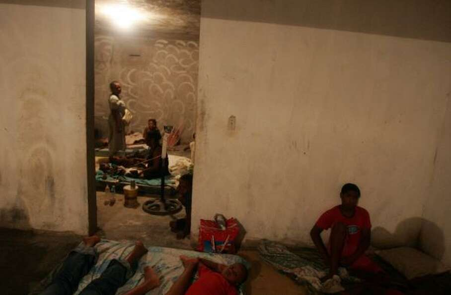 Families take refuge for protection from Hurricane Dean in Pedernales, Dominican Republic, about 200