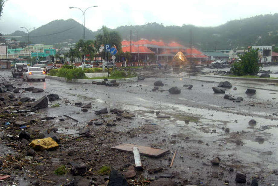 Debris covers a highway in Castries, St. Lucia, after Hurricane Dean passed on Friday. Photo: Tim James, AP