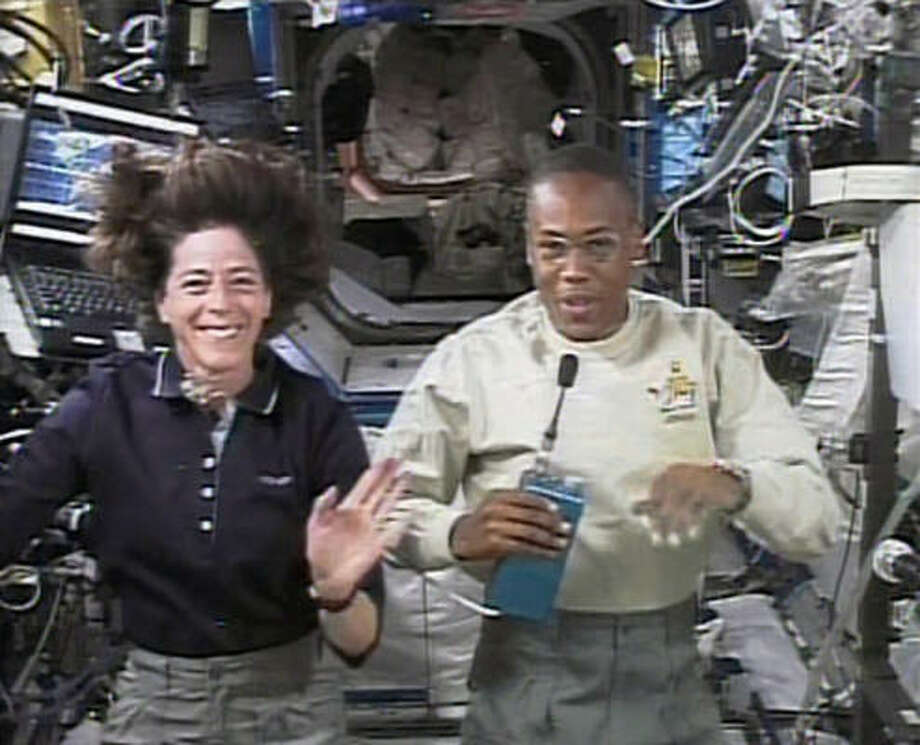 Barbara Morgan and Alvin Drew Jr. hold a news conference Thursday from the international space station. Photo: NASA