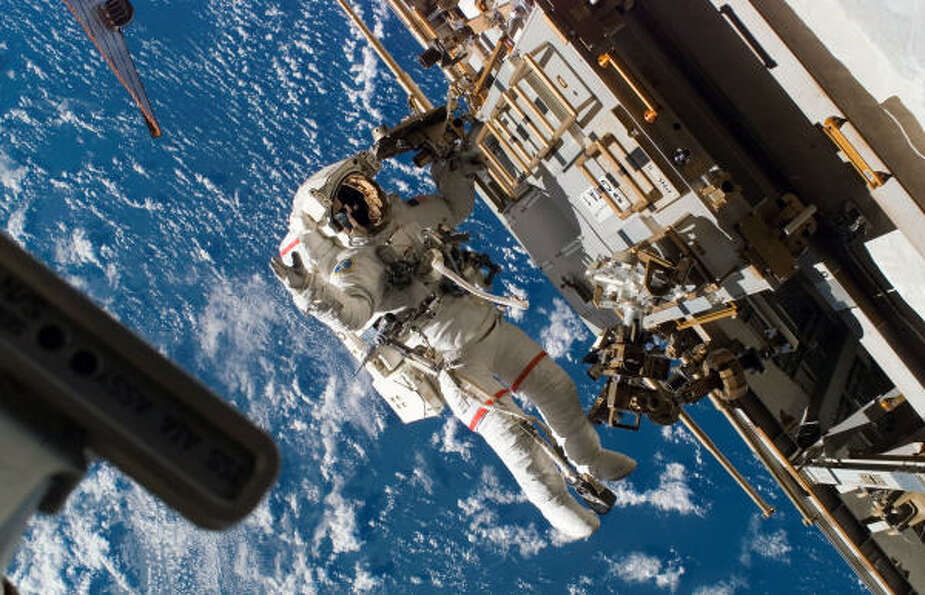 Another view Wednesday shows astronaut Rick Mastracchio working on the space station with Earth as a