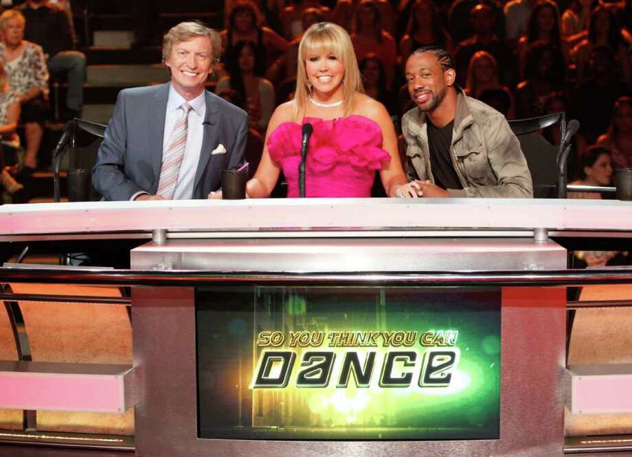 "In this image released by Fox, judges from left, Nigel Lythgoe, Mary Murphy and Lil' C, from the dance competition series ""So You Think You Can dance,"" are shown on Aug. 4, 2011 in Los Angeles. Photo: Adam Rose"