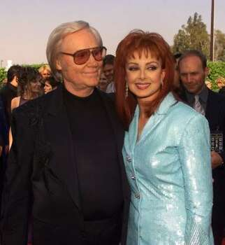 Country stars George Jones and Naomi Judd arrive at the 35th Annual Academy of Country Music Awards in Universal City, Calif., Wednesday, May 3, 2000. Photo: KEVORK DJANSEZIAN, AP