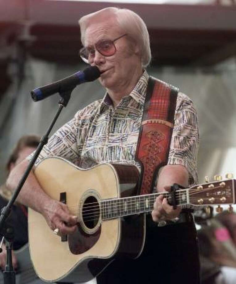 Country music legend George Jones performs Sinners and Saints during the opening day of FanFair '99 in Nashville, Tenn. Photo: JOHN RUSSELL, AP