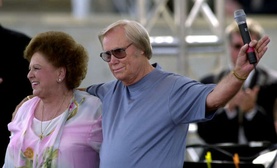 George Jones waves after performing Amazing Grace with Vestal Goodman, left, at the grand opening of the new Country Music Hall of Fame and Museum May 17, 2001 in Nashville, Tenn. Photo: MARK HUMPHREY, AP
