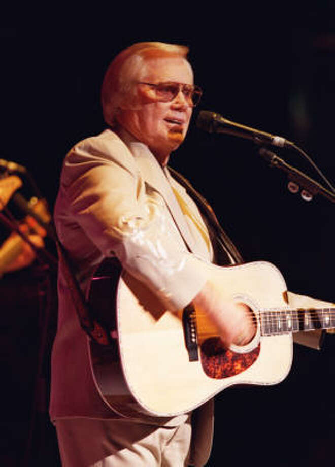 George Jones gave a 90-minute performance before a packed house Oct. 25, 2001 at the Arena Theater in southwest Houston. Photo: Karl Stolleis, Houston Chronicle