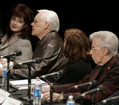 George Jones, second from left, spoke about media ownership before the FCC on Dec. 11, 2006 in Nashville, Tenn. With Jones was Naomi Judd, Jones, Jenny Toomey and Porter Wagoner. Photo: MARK HUMPHREY, AP