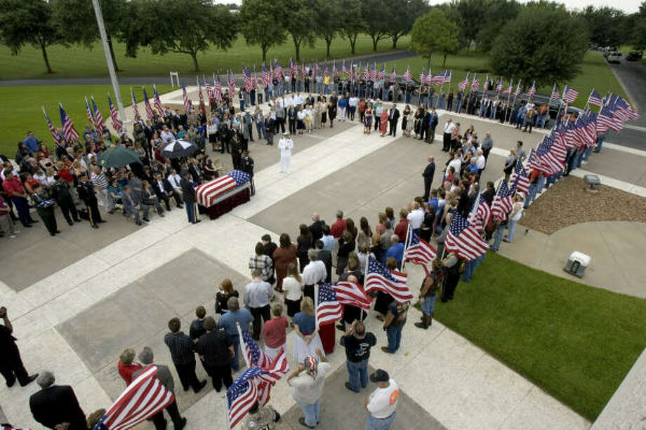 Mourners gather around the casket of Cpl. Zachary Endsley during the soldier's funeral Friday in Houston. Endsley was killed July 23 while on combat duty in Afghanistan. Photo: Brett Coomer, Chronicle