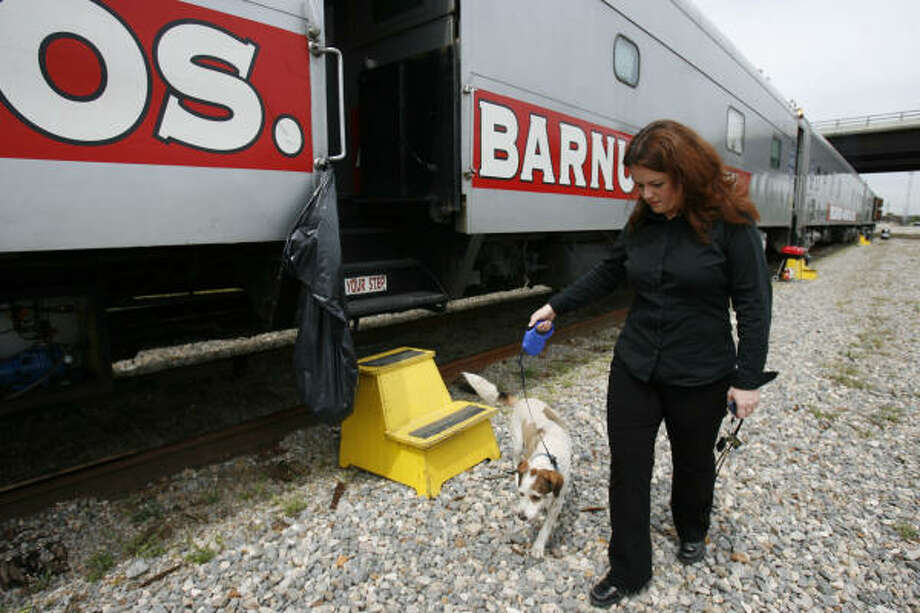 Georgia Stephenson, production manager of Ringling Bros. & Barnum and Bailey Circus, walks her dog Waggy in front of the circus train at the train yard at T.C. Jester and I-10 on Thursday. Stephenson oversees details of each circus performance. Photo: Sharon Steinmann, Chronicle
