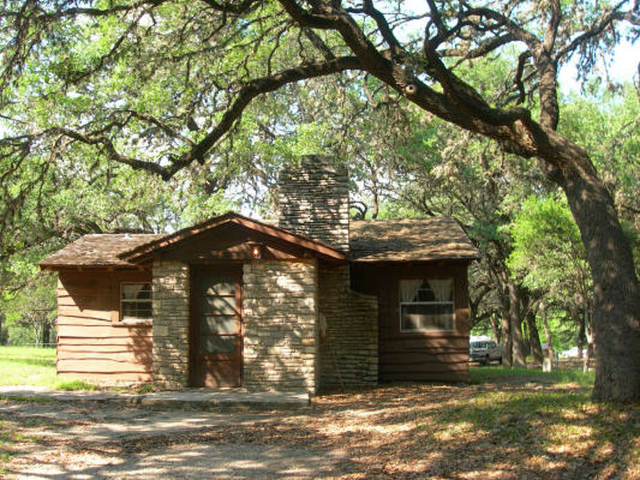 The cabins in Garner State Park, built in the 1930s by the Civilian Conservation Corps, have seen better days. Although conveniently situated within walking distance of the Frio River, they desperately need an overhaul, including air-conditioning. Photo: Eileen McClelland, Chronicle