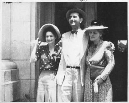 In this undated photo, Lyndon B. Johnson, flanks his wife Lady Bird Johnson, left, and an unidentified woman. Photo: Chronicle File