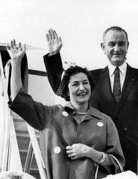 Then-Vice President Lyndon B. Johnson and Lady Bird wave to the crowd at Andrews AFB, Md., in 1961. Photo: CHRONICLE FILE