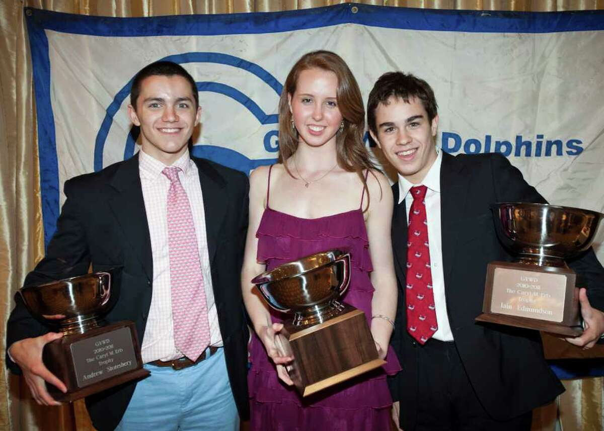 YWCA Dolphins Andrew Stotesbury, Christine McGuire and Iain Edmundson hold their trophies after being named Caryl Erb award winners.