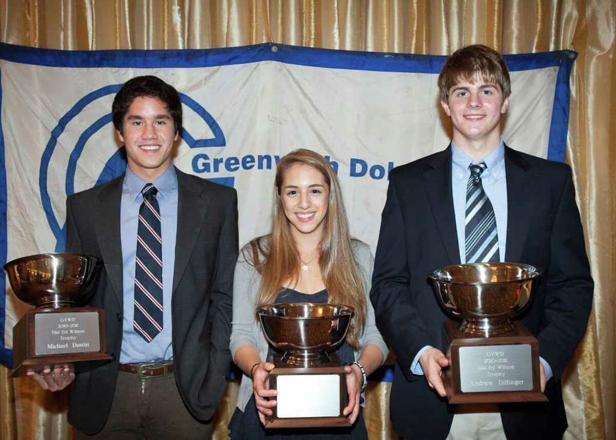 Ed Wilson Award winners Michael Dustin, Kate Madoff and Andrew Dillinger pose with their trophies.