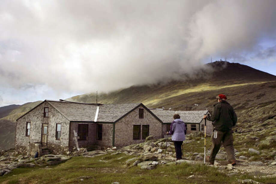 Hikers arrive at the Lakes of the Clouds hut. Photo: Robert F. Bukaty, Associated Press