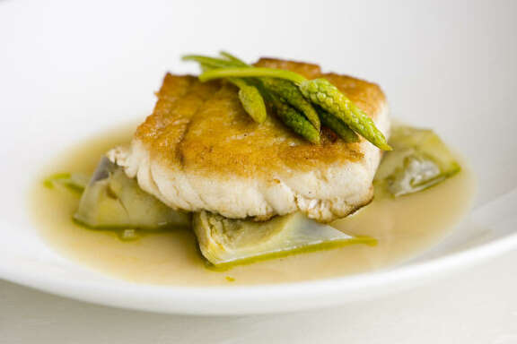 Seared Triple Tail with artichoke barigoule is a featured dish at the Reef restaurant.