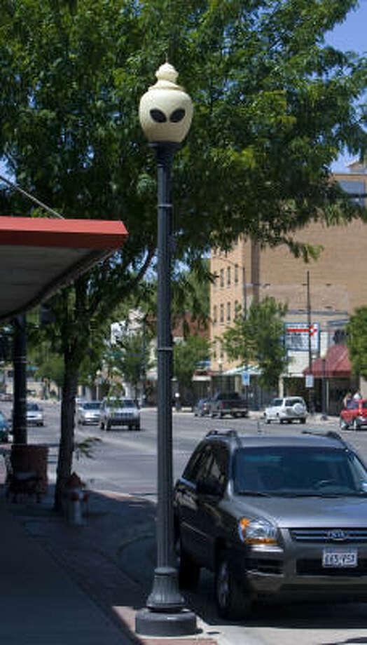 Alien eyes adorn a lamppost along Main Street in downtown Roswell, N.M. Photo: Jake Schoellkopf, Associated Press