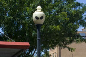 Alien eyes adorn a lamppost along Main Street in downtown Roswell, N.M.