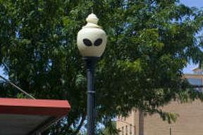 Alien eyes adorn a lamppost along Main Street in downtown Roswell, N.M.