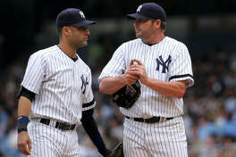 It's just like old times as Yankees shortstop Derek Jeter offers 44-year-old Roger Clemens some words of encouragement before the Rocket made his 2007 debut at Yankee Stadium.