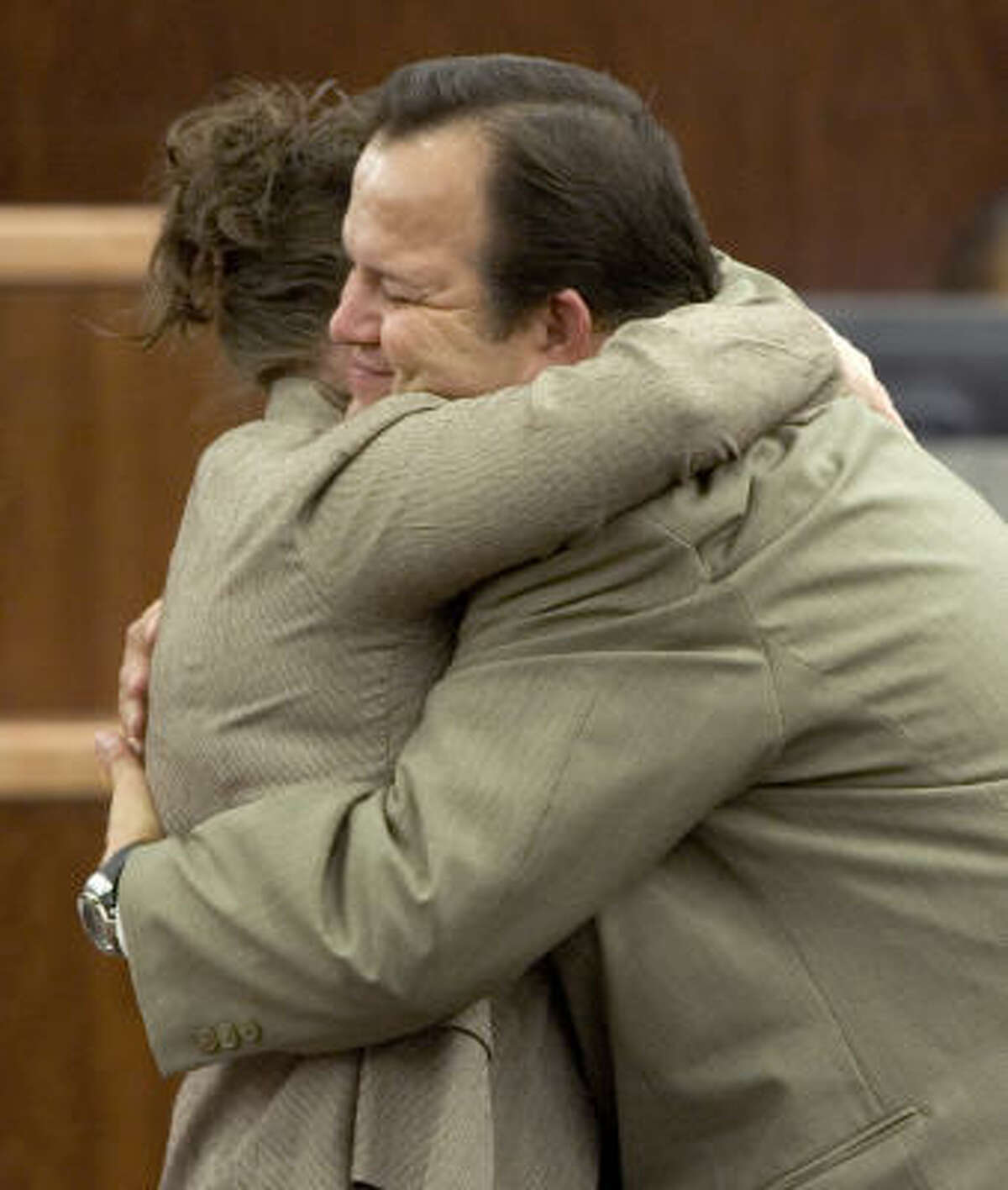 Former Pasadena school bus driver Jerry Cook embraces his wife Annette after he was found not guilty of manslaughter charges Thursday. Prosecutors alleged Cook caused the death of nine-year-old Ruth Young.