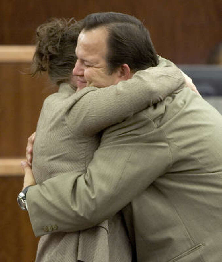 Former Pasadena school bus driver Jerry Cook embraces his wife Annette after he was found not guilty of manslaughter charges Thursday. Prosecutors alleged Cook caused the death of nine-year-old Ruth Young. Photo: Brett Coomer, Chronicle
