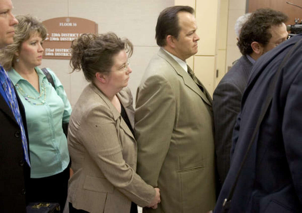 Former Pasadena school bus driver Jerry Cook holds hands with his wife Annette as he leaves the courtroom after he was found not guilty of manslaughter charges. After more than eight hours of deliberations, the jury returned a not guilty verdict.