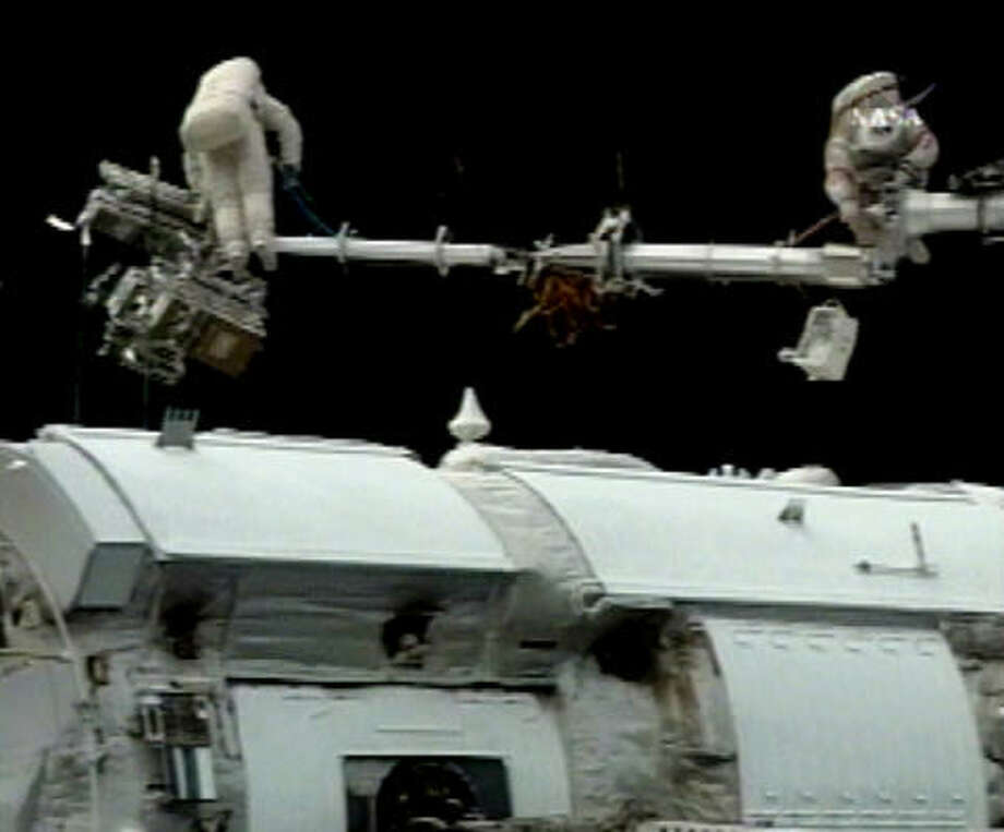 Russian cosmonauts Fyodor Yurchikhin and Oleg Kotov installed protective panels on the international space station's exterior Wednesday to guard against potentially dangerous space debris. Photo: AP/NASA TV