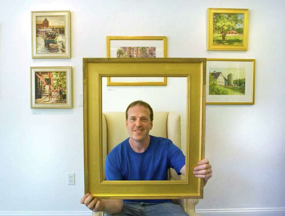 John O'Sullivan, owner of Art & Frame in Danbury, is using his framing business as a gallery for artists to display their work.  The work currently on his walls is by Ruth Newquist of Newtown.  This photo was taken on Friday, Aug. 12, 2011 Photo: Jason Rearick / The News-Times