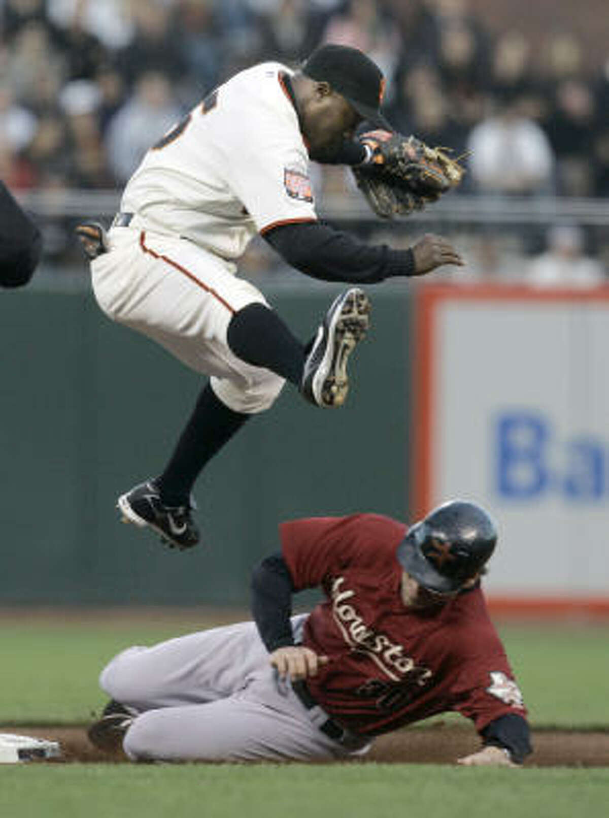 San Francisco second baseman Ray Durham avoids a sliding Luke Scott to turns a double play on Hunter Pence's ground ball to shortstop in the fourth inning.