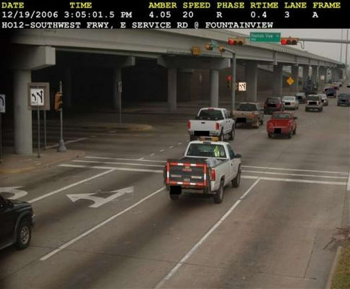 A red-light camera catches a public works vehicle.