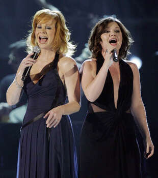 "Reba McEntire, left, and Kelly Clarkson perform ""Because of You"" during the 42nd Annual Academy of Country Music Awards. Photo: Mark J. Terrill, AP"