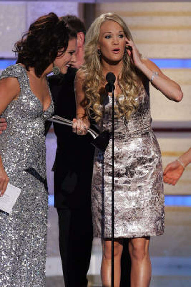Martina Mcbride, left, presents singer Carrie Underwood the Album of the Year award onstage during the 42nd Annual Academy Of Country Music Awards. Photo: Ethan Miller, Getty Images