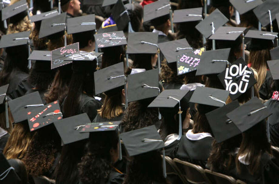 Students express emotions, biblical passages, and names on top of their graduation hats during the College of Education commencement ceremony at University of Houston in the Hoffheinz Pavilion on Saturday. Photo: Mayra Beltran, Chronicle