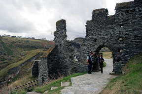 Emily Lovering talks with Robert Tremain, a site supervisor at Tintagel Castle, on the coast of southwestern England.