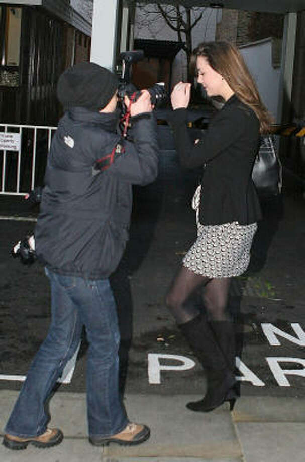 Kate Middleton is met by photographers outside her London home, Jan. 9. Photo: Lewis Whyld, Associated Press