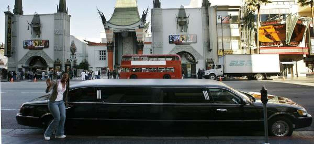 A limousine, parked across the street from Grauman's Chinese Theatre in Hollywood, Calif., is one form of transportation for tourists visiting during the Academy Awards.