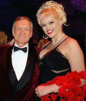 In this 2003 photo, Anna Nicole Smith poses with Hugh Hefner during Playboy's 50th anniversary party at the Playboy Mansion in Los Angeles. Photo: Playboy