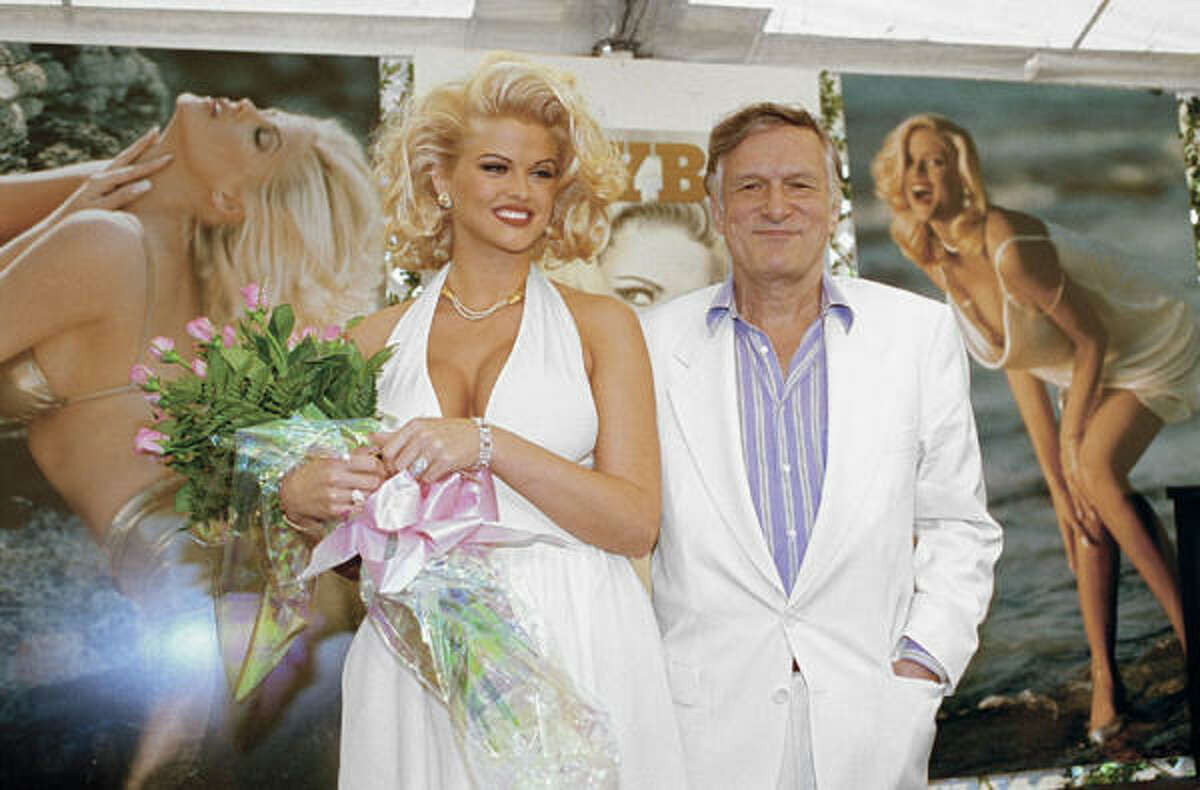 1993: Anna Nicole Smith poses with Hugh Hefner during the Playmate of the Year announcement in May 1993 at the Playboy Mansion in Los Angeles.