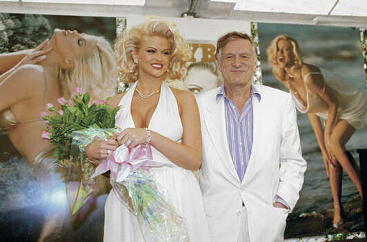 Anna Nicole Smith poses with Hugh Hefner during the Playmate of the Year announcement in May 1993 at the Playboy Mansion in Los Angeles. Photo: Playboy