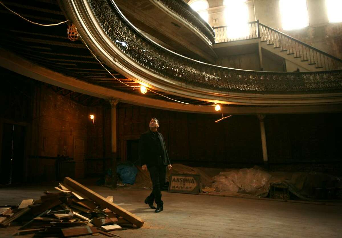Opera singer Roberto Iarussi checks out the Sterling Opera House on Elizabeth Street in Derby, Conn, on Wednesday, October 14, 2009. Iarussi was starring in a promotional video for his upcoming performance at Griffin Hospital's Centennial Gala on Saturday, October 24.